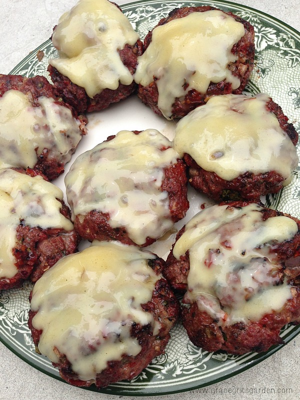 Grilled Basil Burgers topped with Fontina Cheese