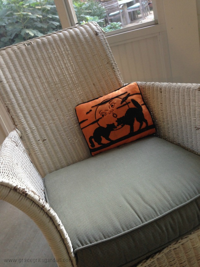 Halloween pillow on vintage rocker - back porch decor